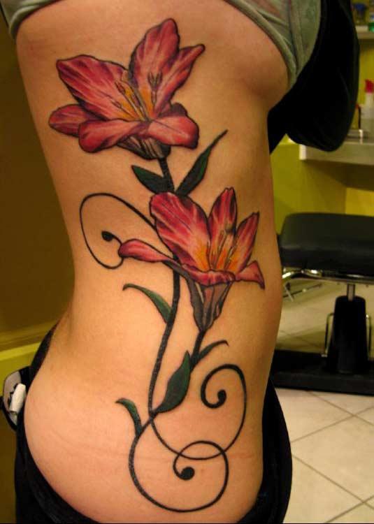 tatuajes flores abdomen