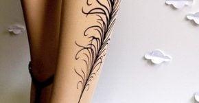 tatuaje pluma pavoreal