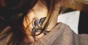 girl tattoos neck