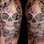 Tatuaje de budha en el brazo