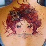 Tatuaje caricatura espalda