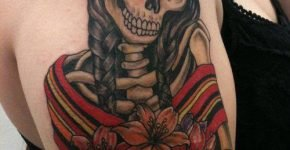 Skull girl tattoo