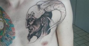 Demon's tattoo on chest