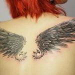 Tatuaje de un ancla como clave de Sol