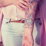 Tatuaje del kraken en hombro y brazo
