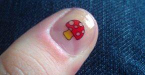 shroom nail tattoo