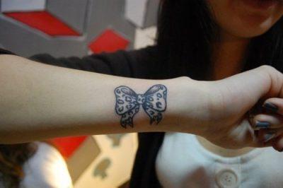 Ribbon tattoo for girl