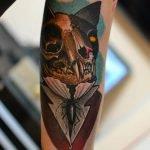 Par de flechas tatuadas