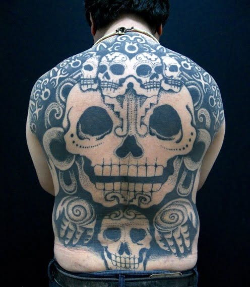 Skull tattoos on the back