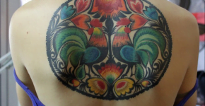 Rooster tattoos on the back