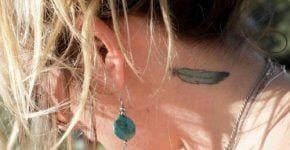 feather tattoo on the neck