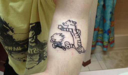 Calvin and Hobbes arm tattoo