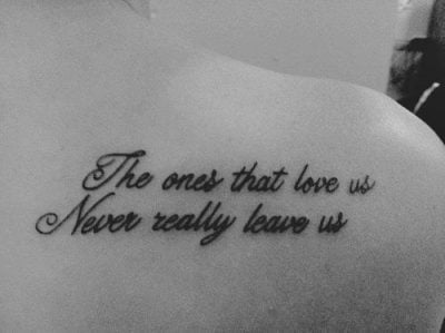 Italics tattoo on the back