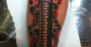 Black lighthouse tattoo