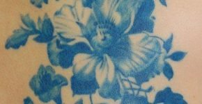 Blue ink flower tattoo