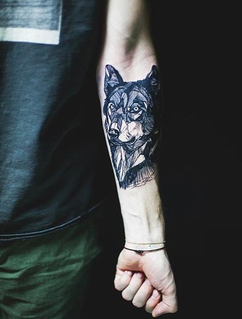 Wolf tattoo on forearm