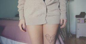 Hipster heart tattoo on leg