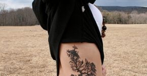Tree tattoo on hip and stomach