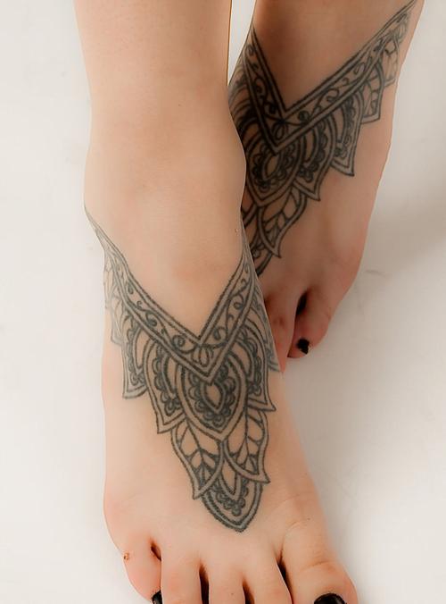 mandala tattoo on feet