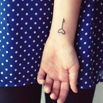Small key tattoo on wrist