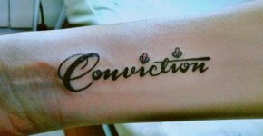 Conviction arm tattoo