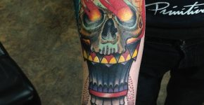 Skull with fire eyes tattoo
