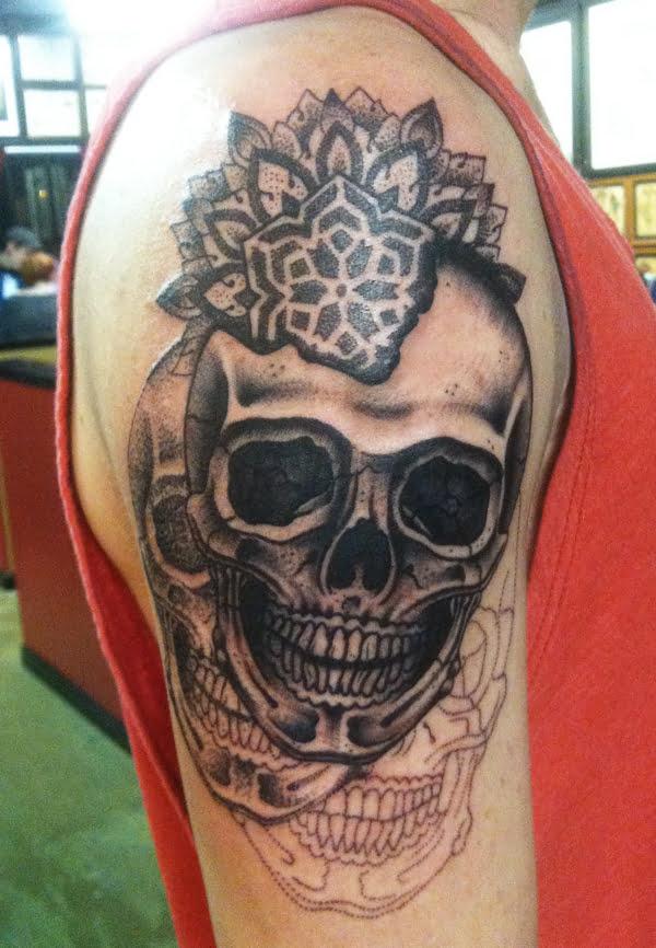 Skull tattoos on shoulder