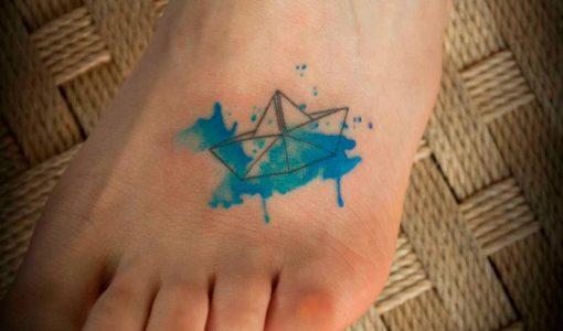 Origami boat tattoo