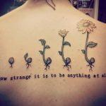 Tatuaje de sol en costillas