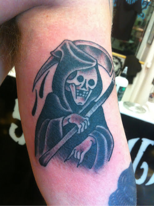 The Grim forearm tattoo