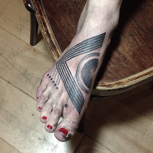 Mxm Foot tattoo