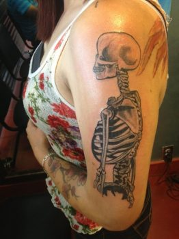 Skeleton tattoo on arm and shoulder