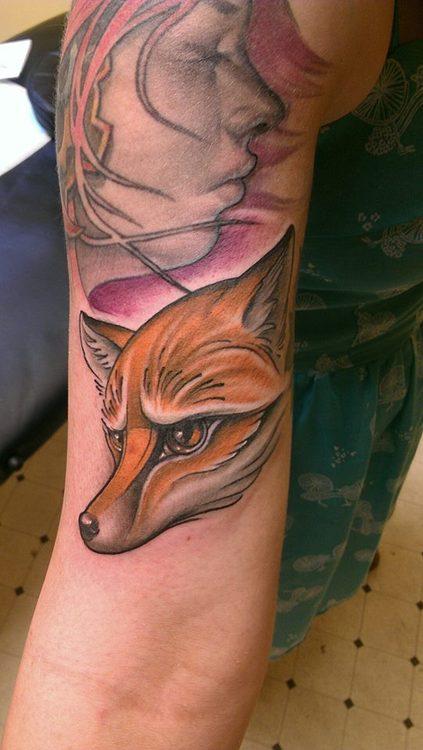 Fox tattoo on arm
