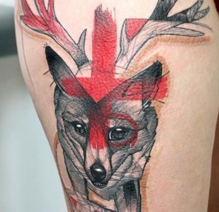Fox tattoo on leg