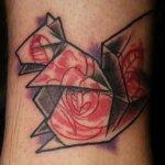 Rosa y girasol en hombro
