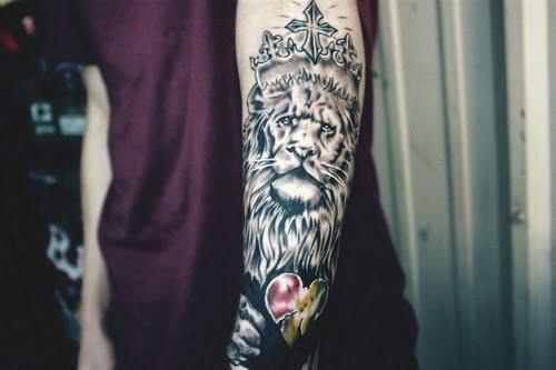 Lion tattoo on arm