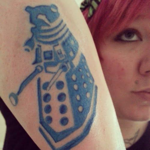 Tatuaje raro en el antebrazo