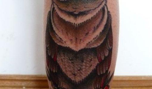 Owl tattoo on leg