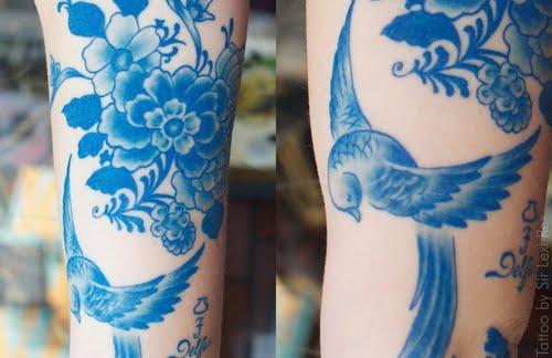 Tatuaje paisaje primaveral en la pierna