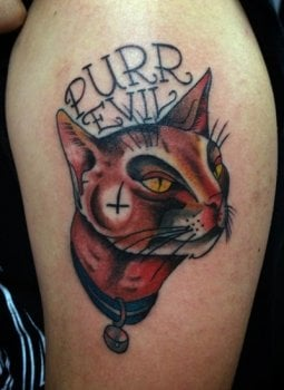 Tatuaje Purr Evil en el brazo