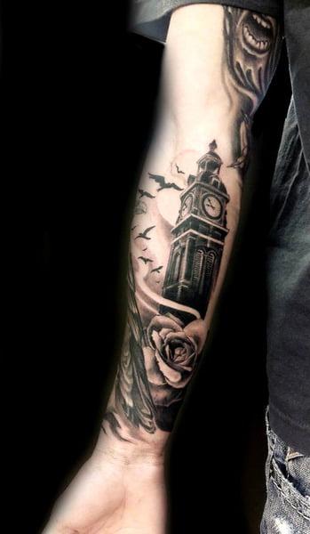 Tatuaje torre reloj