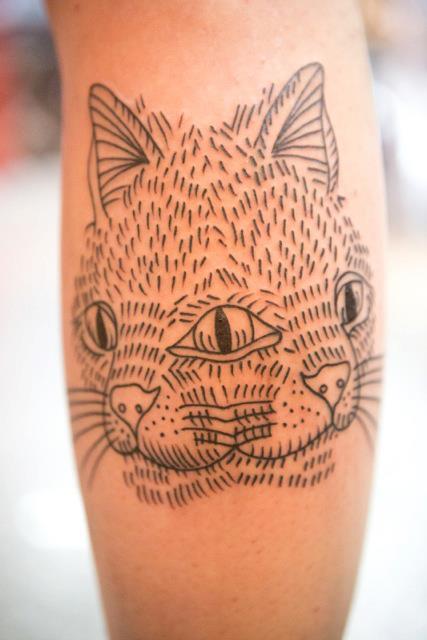 Tatuaje gato cabezas
