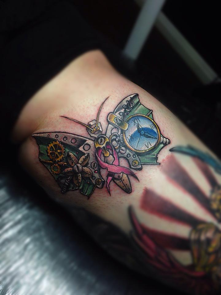 Tatuaje mariposa mecánica