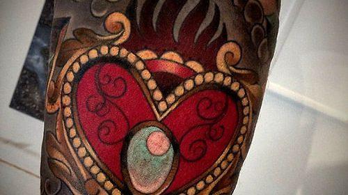 Tatuaje de mariposa en la pierna
