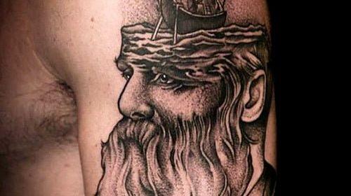 Tatuaje de rosa y amapola en las piernas