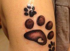 Tatuaje huellas perro
