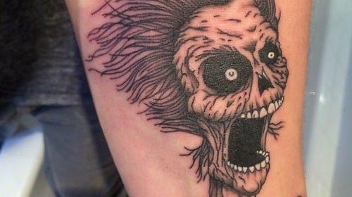 Tatuaje de girasol en el brazo