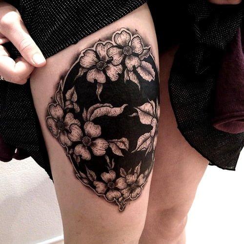 Tatuaje círculo floral