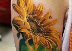 Tatuaje girasol en el brazo