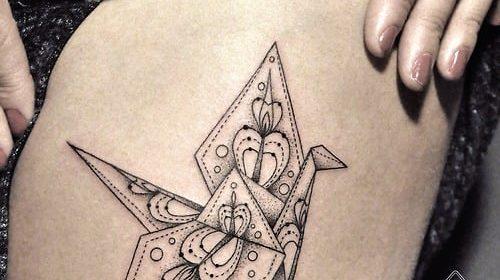 Tatuaje de mariposa con efecto de acuarela